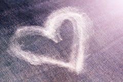 Καρδιά με την κιμωλία στα τζιν Στοκ Φωτογραφία