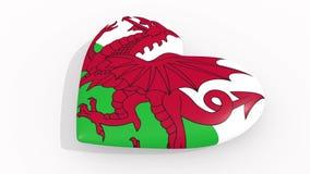 Καρδιά στα χρώματα και τα σύμβολα της Ουαλίας στο άσπρο υπόβαθρο, βρόχος απεικόνιση αποθεμάτων