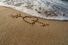 Καρδιά στην άμμο Στοκ Φωτογραφίες