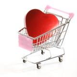 Καρδιά στο κάρρο αγορών Στοκ Εικόνες