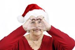 καρδιά grandma που κάνει το σύμβ&omi Στοκ Εικόνα