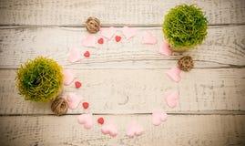 Καρδιές και λουλούδια πλαισίων Στοκ Φωτογραφία
