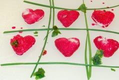 Καρδιές σε ένα δίκτυο Στοκ Φωτογραφία