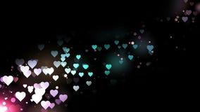 Καρδιές χρώματος που πετούν στο μαύρο υπόβαθρο Αφηρημένη ζωτικότητα βρόχων διακοπών ημέρας βαλεντίνων ελεύθερη απεικόνιση δικαιώματος