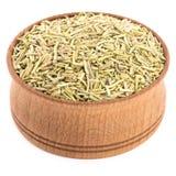 Καρυκεύματα της Rosemary σε ένα ξύλινο κύπελλο Στοκ Εικόνα