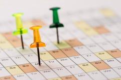 Καρφίτσες στο ημερολόγιο στοκ εικόνα με δικαίωμα ελεύθερης χρήσης
