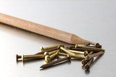 Καρφιά και μολύβι μολύβδου Στοκ Φωτογραφία