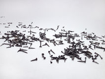 Καρφιά παπουτσιών, που διασκορπίζονται σε χαρτί Στοκ Εικόνες
