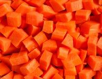Καρότα που τεμαχίζονται στα κομμάτια Στοκ Φωτογραφία