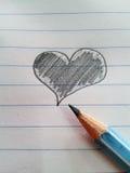 Καρδιά και μολύβι Στοκ Εικόνες
