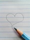Καρδιά και μολύβι Στοκ Φωτογραφίες