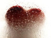 Καρδιά που ενσωματώνεται κόκκινη στον πάγο Στοκ Εικόνα