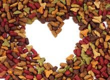 Καρδιά πλαισίων των τροφίμων κατοικίδιων ζώων για τη χρήση υποβάθρου Στοκ Εικόνα