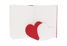 Καρδιά της κόκκινης και Λευκής Βίβλου στο κενό ανοικτό βιβλίο που απομονώνεται στο λευκό στοκ εικόνες