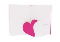 Καρδιά της ρόδινης και Λευκής Βίβλου στο κενό ανοικτό βιβλίο που απομονώνεται στο λευκό στοκ εικόνα