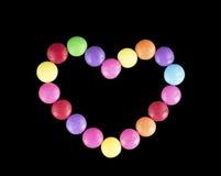 Καρδιά της χρωματισμένης καραμέλας Στοκ Εικόνες