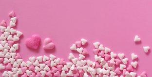 Καρδιές ζάχαρης του ρόδινου backround Στοκ φωτογραφία με δικαίωμα ελεύθερης χρήσης