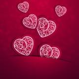 Καρδιές με ένα σχέδιο σε ένα πορφυρό υπόβαθρο Στοκ Εικόνες