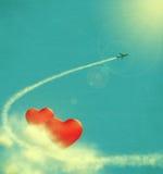 Καρδιές στα σύννεφα και airplan Στοκ εικόνα με δικαίωμα ελεύθερης χρήσης