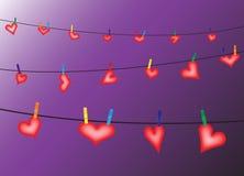 Καρδιές στη γραμμή στην πορφύρα Στοκ Εικόνες