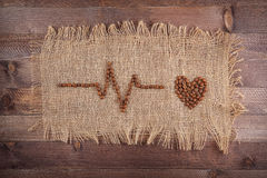 Καρδιογράφημα των φασολιών καφέ στην απόλυση Στοκ Φωτογραφίες
