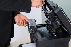 Κασέτα καθορισμού επιχειρηματιών στη μηχανή φωτοτυπιών Στοκ Φωτογραφία