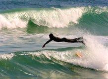κατάδυση surfer Στοκ Φωτογραφία