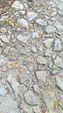 κατάλληλη σύσταση φωτός του ήλιου οδικών πετρών ανασκόπησης ασφάλτου Στοκ Φωτογραφία