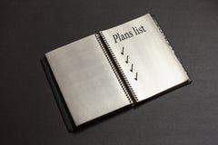 Κατάλογος επιχειρηματικών σχεδίων στο σημειωματάριο στοκ εικόνες
