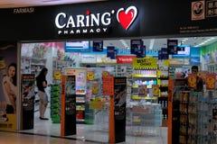 Κατάστημα φαρμακείων φροντίδας στη Μαλαισία στοκ εικόνες