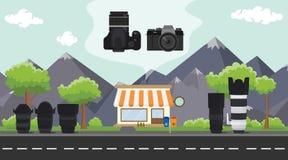 Κατάστημα ψηφιακών κάμερα στο πεζοδρόμιο με το δέντρο και βουνό ως υπόβαθρο Στοκ φωτογραφίες με δικαίωμα ελεύθερης χρήσης