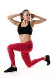 Κατάλληλη γυναίκα που κάνει μια τεντώνοντας άσκηση Στοκ φωτογραφία με δικαίωμα ελεύθερης χρήσης
