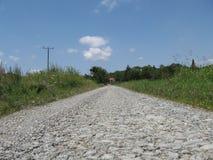 κατάλληλη σύσταση φωτός του ήλιου οδικών πετρών ανασκόπησης ασφάλτου στοκ εικόνες με δικαίωμα ελεύθερης χρήσης