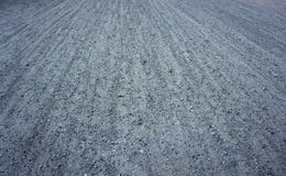 κατάλληλη σύσταση φωτός του ήλιου οδικών πετρών ανασκόπησης ασφάλτου Στοκ Εικόνα