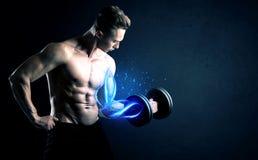 Κατάλληλο βάρος ανύψωσης αθλητών με την μπλε ελαφριά έννοια μυών Στοκ εικόνα με δικαίωμα ελεύθερης χρήσης