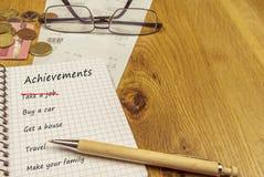 Κατάλογος επιτευγμάτων σε ένα σπειροειδές σημειωματάριο στοκ εικόνα