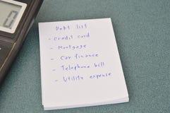 Κατάλογος και υπολογιστής χρέους στον πίνακα Στοκ εικόνα με δικαίωμα ελεύθερης χρήσης