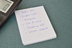 Κατάλογος και υπολογιστής χρέους στον πίνακα Στοκ εικόνες με δικαίωμα ελεύθερης χρήσης