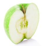 Κατά το ήμισυ πράσινο μήλο στοκ φωτογραφία