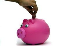 καταθέτοντας χρήματα Στοκ φωτογραφία με δικαίωμα ελεύθερης χρήσης