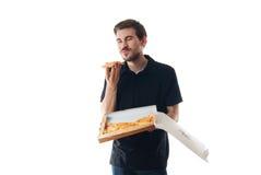 κατανάλωση των νεολαιών πιτσών ατόμων Στοκ Φωτογραφίες
