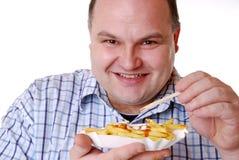 κατανάλωση των τηγανιτών π&alph Στοκ Φωτογραφία