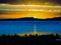 Καταπληκτικό ηλιοβασίλεμα από την παραλία στην Τασμανία, Αυστραλία Στοκ Εικόνες