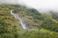 Καταρράκτες στα misty βουνά. Στοκ φωτογραφία με δικαίωμα ελεύθερης χρήσης