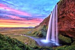 Καταρράκτης Seljalandfoss στο ηλιοβασίλεμα, Ισλανδία στοκ εικόνες με δικαίωμα ελεύθερης χρήσης