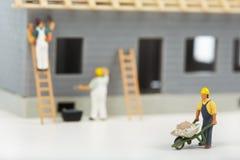 Κατασκευή των εξοχικών σπιτιών Εργαζόμενοι Στοκ Εικόνες