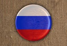 Κατασκευασμένο στρογγυλό ξύλο σημαιών της Ρωσίας στο τραχύ ύφασμα Στοκ Εικόνα