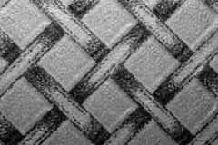 Κατασκευασμένο σχέδιο υπό μορφή υφαμένων τετραγώνων Στοκ φωτογραφίες με δικαίωμα ελεύθερης χρήσης