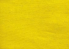Κατασκευασμένο υπόβαθρο του κίτρινου υφάσματος στοκ εικόνες