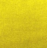 Κατασκευασμένο υπόβαθρο του κίτρινου υφάσματος στοκ φωτογραφία με δικαίωμα ελεύθερης χρήσης